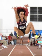 Taliyah Brooks of Arkansas jumps 20-10 1/2 (636m) for the top mark in the pentathlon long jump during the NCAA Indoor Track and Field Championships.