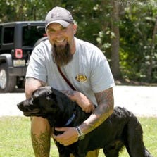 Scott was paired with a dog whose main role was to notify him when he started showing symptoms of PTSD.