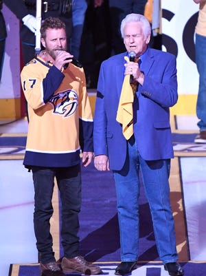 Dierks Bentley and Del McCoury sing the National Anthem before game 1 of the second round NHL Stanley Cup Playoffs at the Bridgestone Arena Friday, April 27, 2018, in Nashville, Tenn.