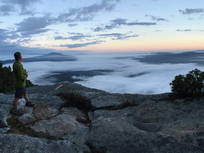 A panoramic sunrise view of the fog-shrouded valley