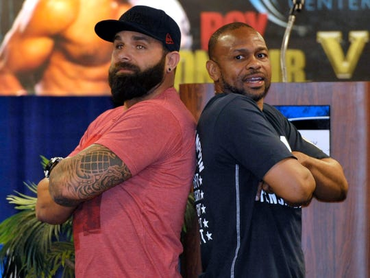 MMA fighter Dillon Cleckler and boxing legend Roy Jones, Jr. pose back to back for photos during a press conference to promote the upcoming Island Fights 33 event. Cleckler will make his fighting return to the Bay Center on Friday night.