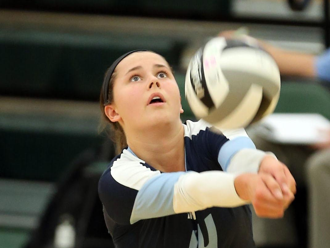 Mount Notre Dame's Margo Wolf gets a dig during a Cougars volleyball game against Ursuline. Margo is the daughter of Greg Wolf and now plays at Dayton.