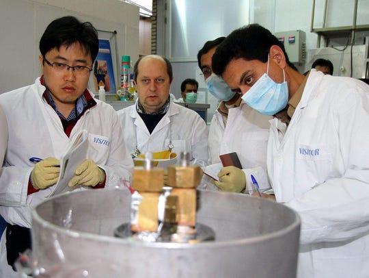 An IAEA team checks the enrichment process inside the