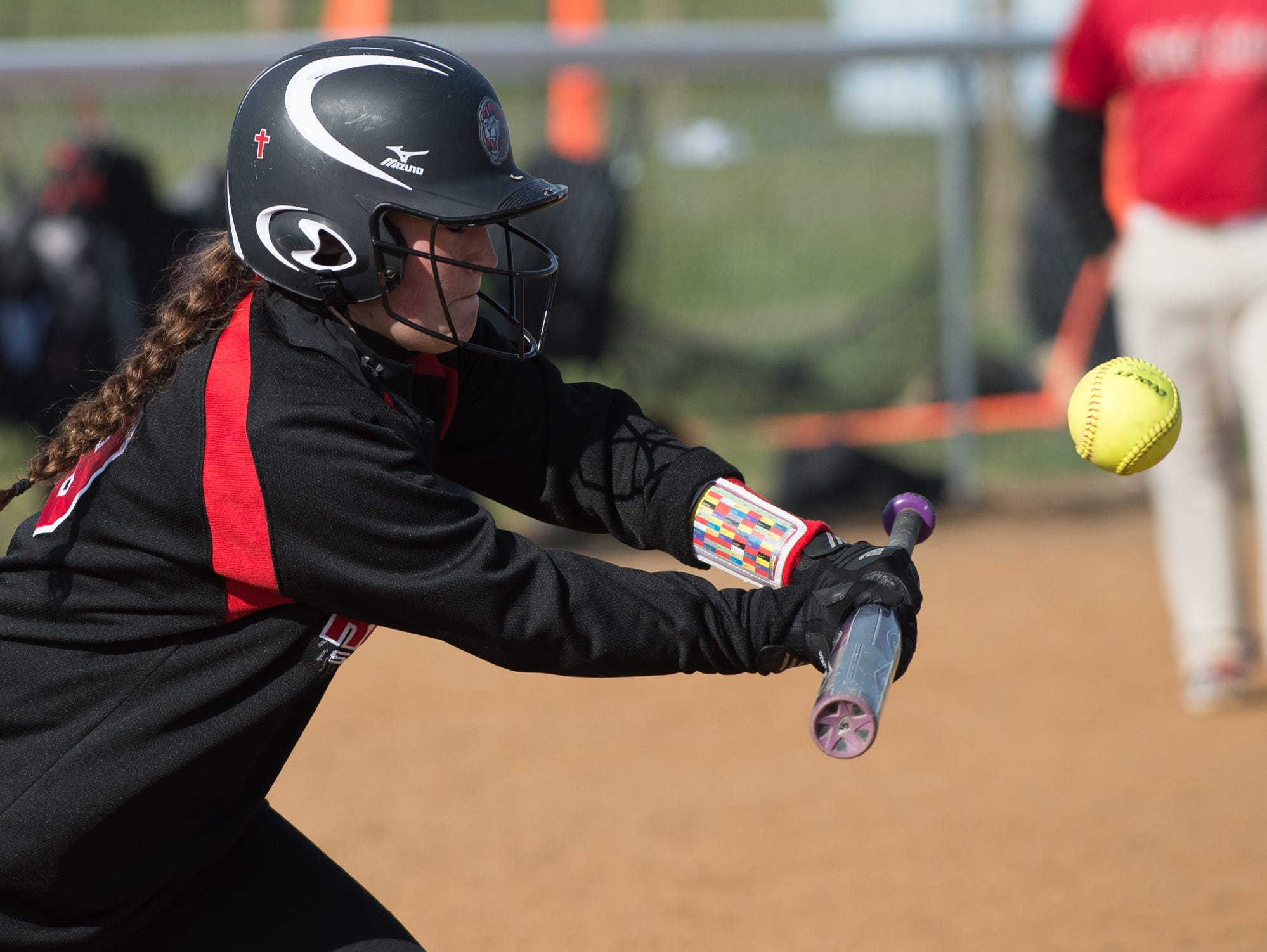 Red Lion's Colleen McAllister (19) bunts the ball in their game against Lake Forest on Friday.