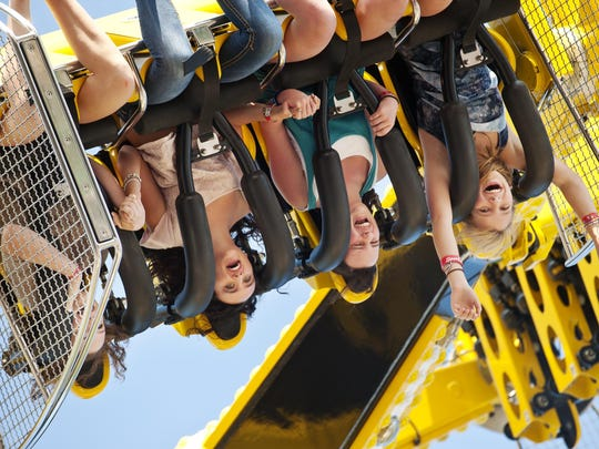 Addie Price of Jericho (from left), Sierra Aguiar of Jericho, Rebecca Sprano of Huntington and Kay Groff of Underhill Center are flipped upside down on The Stinger the Champlain Valley Fair in Essex Junction in 2012.