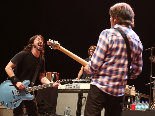 Musician Dave Grohl (left) with John Fogerty performs at Hammerstein Ballroom in New York City. Grohl, who frequently spends summer vacations in Rehoboth Beach, has a new HBO project coming this fall.