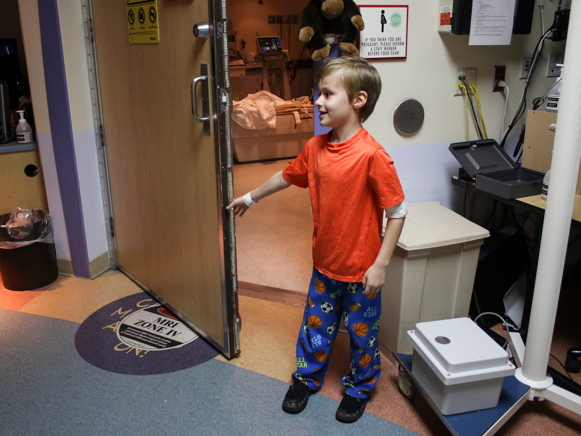 Noah Coffman, 6, waits for his MRI to begin on Feb.