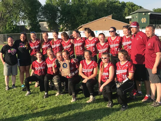 The Fond du Lac softball team poses with the regional title plaque after beating Oshkosh North 5-3 on Thursday.