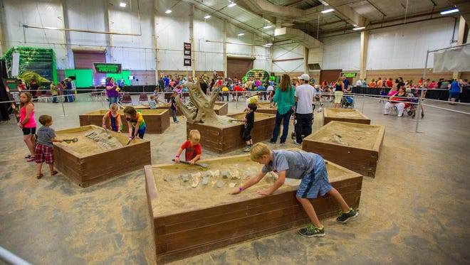 Kids dig for fossils at Jurassic Quest, which is coming to the Richland County Fairgrounds this weekend.