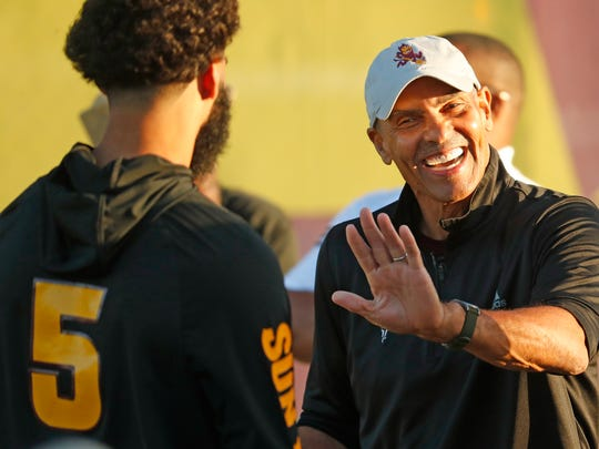 ASU head coach Herm Edwards jokes with quarterback