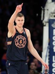 New York Knicks forward Kristaps Porzingis (6) reacts after scoring against the Brooklyn Nets during the second quarter of an NBA basketball game, Tuesday, Jan. 30, 2018, in New York.
