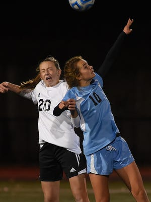 Brianna Crowley (no.20) of Parsippany Hills and Sarah Jordan (no.10) of Mahwah competing for the header in the first half during the Group 2 soccer semifinal at Livingston High School on Tuesday.