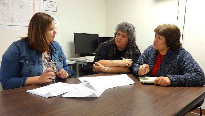 From left, Jessica Etcheverry of Luna County is joined by Workforce Connection Employment Specialists Maria Snyder and Nickolasa Casillas to put the final touches on Friday and Saturday's Business Expo.