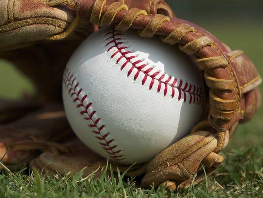 636341240305342474-baseball-glove-grass.jpg