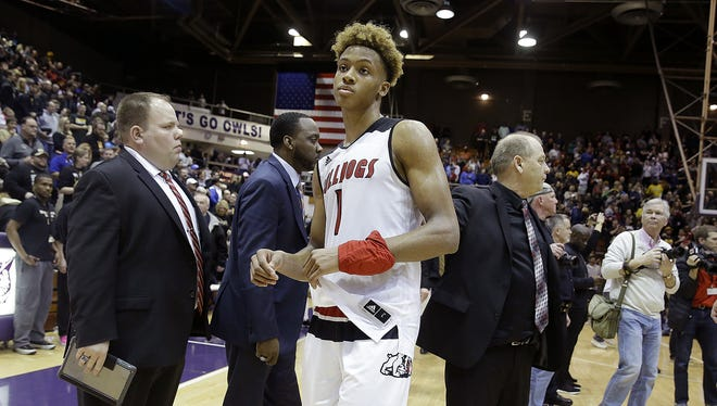 A dejected New Albany Bulldogs Romeo Langford (1) following their IHSAA Boys 4A Semi-State basketball game at the Lloyd E.Scott Gym in Seymour IN.,  on Saturday, March 16, 2018. The Warren Central Warriors  defeated the New Albany Bulldogs 64-62.