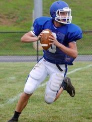 Fort Defiance quarterback #6 Jacob Jones gets ready