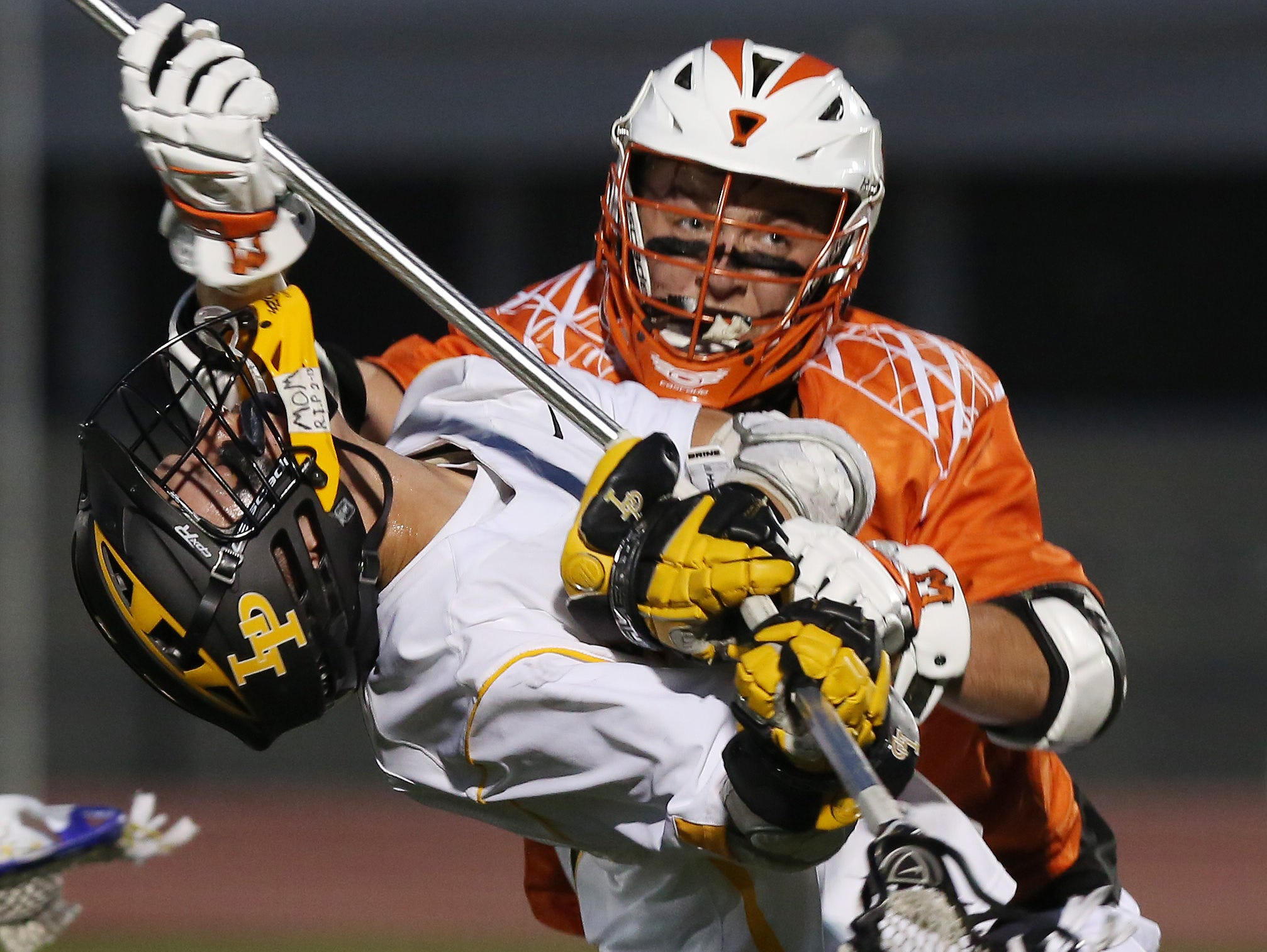 Lakeland/Panas' Joseph Cortese (1) takes a big hit from Mamaroneck's Matt Brodie (10) during the Section 1 championship game at White Plains High School May 25, 2016.