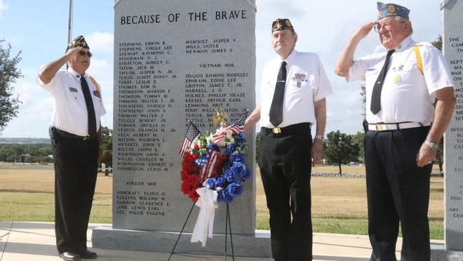From left, American Legion Post 196 commander Tom Gray and post members Henry Uphold and Harold Stieber commemorate National Korean Veterans Armistice Day at the Central Texas Veterans Memorial.