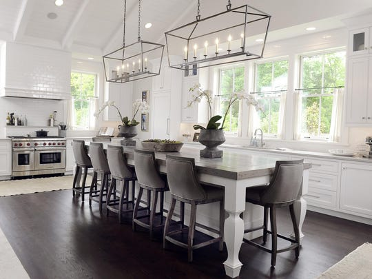 The kitchen features a 13-foot island made with reclaimed