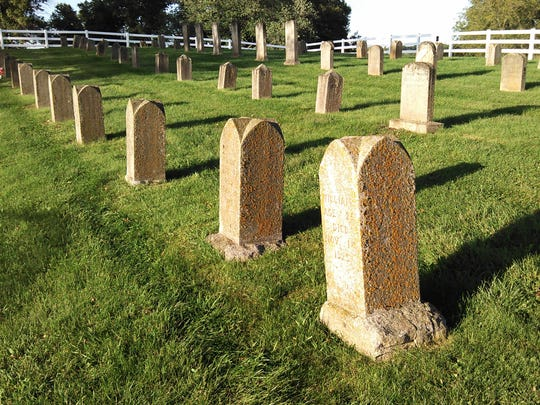 Many of these older tombstones dating from the late 1800s were relocated along with prisoner remains to this site at the current Anamosa State Penitentiary Cemetery in 1913 from a previous cemetery which was closer to the prison.