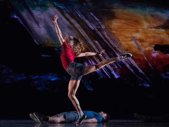 "Kathleen Dahlhoff and Michael Mengden are seen in the Cincinnati premiere of Justin Peck's ""Murder Ballade,"" being performed as part of Cincinnati Ballet's ""Bold Moves"" program. The music, which was performed by Eighth Blackbird, was composed by Cincinnati native Bryce Dessner. In the background, you can see a portion of a massive backdrop painted by Cincinnati artist David Buetsche."