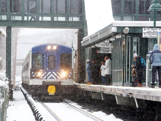 Passengers board a Metro-North train at the Katonah