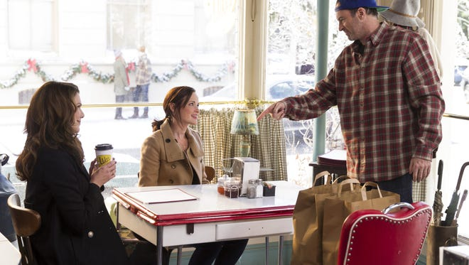 """From left, Lauren Graham, Alexis Bledel and Scott Patterson act in a scene from """"Gilmore Girls: A Year in the Life."""""""