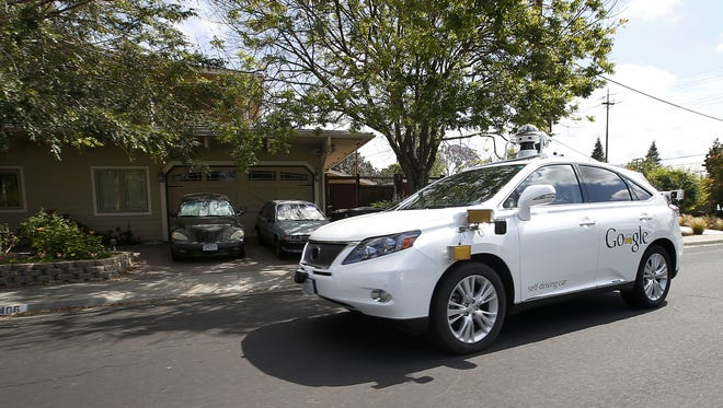 Google's self-driving Lexus drives during a May 2015 demonstration at Google's campus in Mountain View, California. FILE - In this Wednesday, May 13, 2015, file photo, Google's self-driving Lexus car drives along street during a demonstration at Google campus on  in Mountain View, Calif. As Google cars encounter more and more of the obstacles and conditions that befuddle human drivers, the autonomous vehicles are likely to cause more accidents, such as a recent low-speed collision with a bus. (AP Photo/Tony Avelar, File)