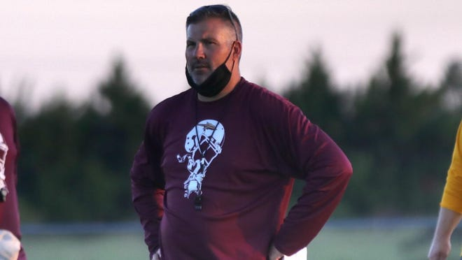 Hays High football coach Tony Crough watches his team practice on Monday evening at Hays High.