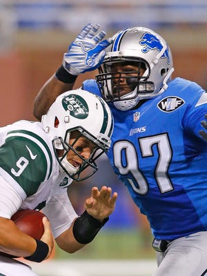 Bryce Petty of the New York Jets is sacked by Caraun Reid of the Detroit Lions during the second quarter of the preseason game on August 13, 2015 at Ford Field Detroit.