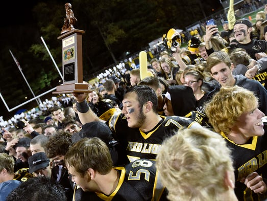 Red Lion captain Nick Argento hoists the Ballyhoo Sports