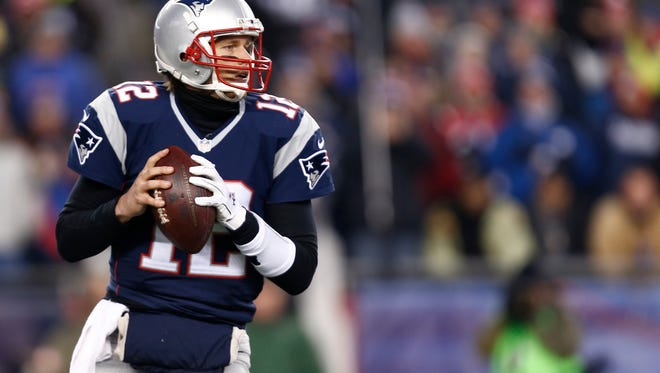 New England Patriots quarterback Tom Brady (12) prepares to throw the ball during against the Baltimore Ravens during the the 2014 AFC Divisional playoff football game at Gillette Stadium on Jan. 10 in Foxborough, Mass.