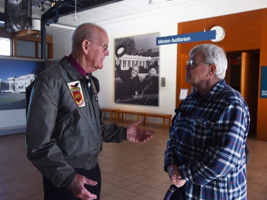 Retired Navy Capt. Bill Kennedy, left, director of the Navy-Marine Corps Relief Society, talks with Petty Officer 1st Class Donald Almeida, right, a former Navy Reservist from Easton, Massachusetts, at the Franklin D. Roosevelt Presidential Library and Museum.