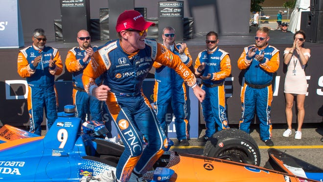 Scott Dixon celebrates after winning an IndyCar auto race in Toronto, Sunday, July 15, 2018.
