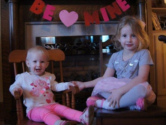 Valentine sisters The Wilson sisters, 21-month-old Alana and 5-year-old Arianna made a picture perfect Valentine greeting, sitting in front of their beautifully decorated mantel. The young ladies' parents are Amanda and Andrew Wilson.