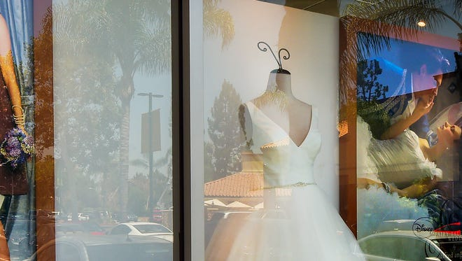 A window display is seen at Alfredo Angelo bridal store in West Covina, Calif., Friday, July 14, 2017. The wedding dress retailer declared bankruptcy late Thursday, July 13, and suddenly shut down all of its stores, leaving customers without answers about how they'll get their dresses that are already on order.