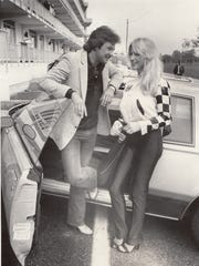 IndyCar driver Tim Richmond talks to Linda Vaughn, best known as Miss Hurst Golden Shifter, at the Indianapolis Motor Speedway May 14, 1981.