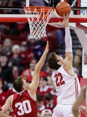 Wisconsin's Ethan Happ (22) shoots against Indiana's Collin Hartman (30) during the first half of an NCAA college basketball game Tuesday, Jan. 2, 2018, in Madison, Wis.