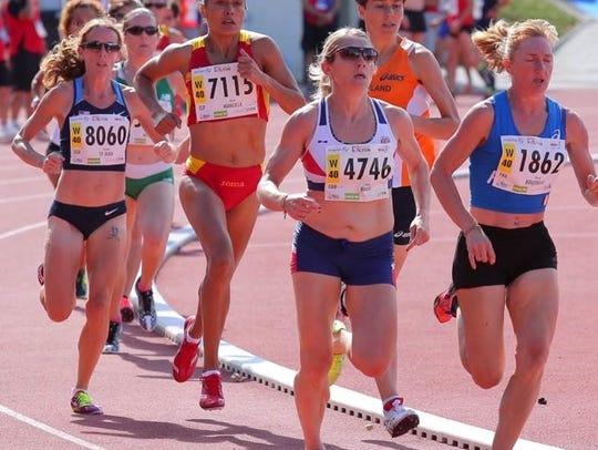 Jennifer St. Jean (number 8060 at left) running at