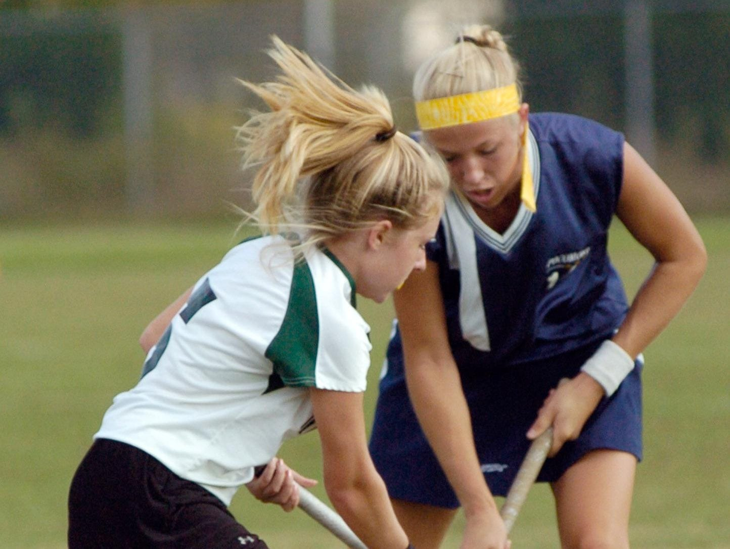 Pocomoke's Brooke Tapman fights for possession with Parkside's Courtney Dennis in this 2006 photo. Tapman said she took the news of former coach Susan Pusey's death hard.