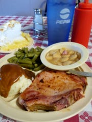 Papaw's Poole Mill Restaurant specializes in good country favorites, such as this moist and tender smoked pork chop with green beans, butter beans and mashed potatoes.