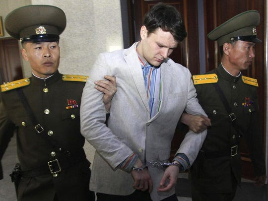 In this March 16, 2016, file photo, American student Otto Warmbier, center, is escorted at the Supreme Court in Pyongyang, North Korea. The Trump administration pledged to pay North Korea $2 million for the medical care of Otto Warmbier in return for his release but didn't follow through, National Security Adviser John Bolton said Sunday, April 28, 2019.