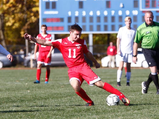 Somers' Jon Rina (11) makes a pass during their 2-1