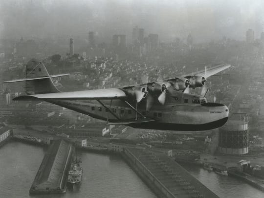 Pan Am's China Clipper flying boat passes over the San Francisco waterfront at the start of its first airmail flight to Manila on Nov. 22, 1935.