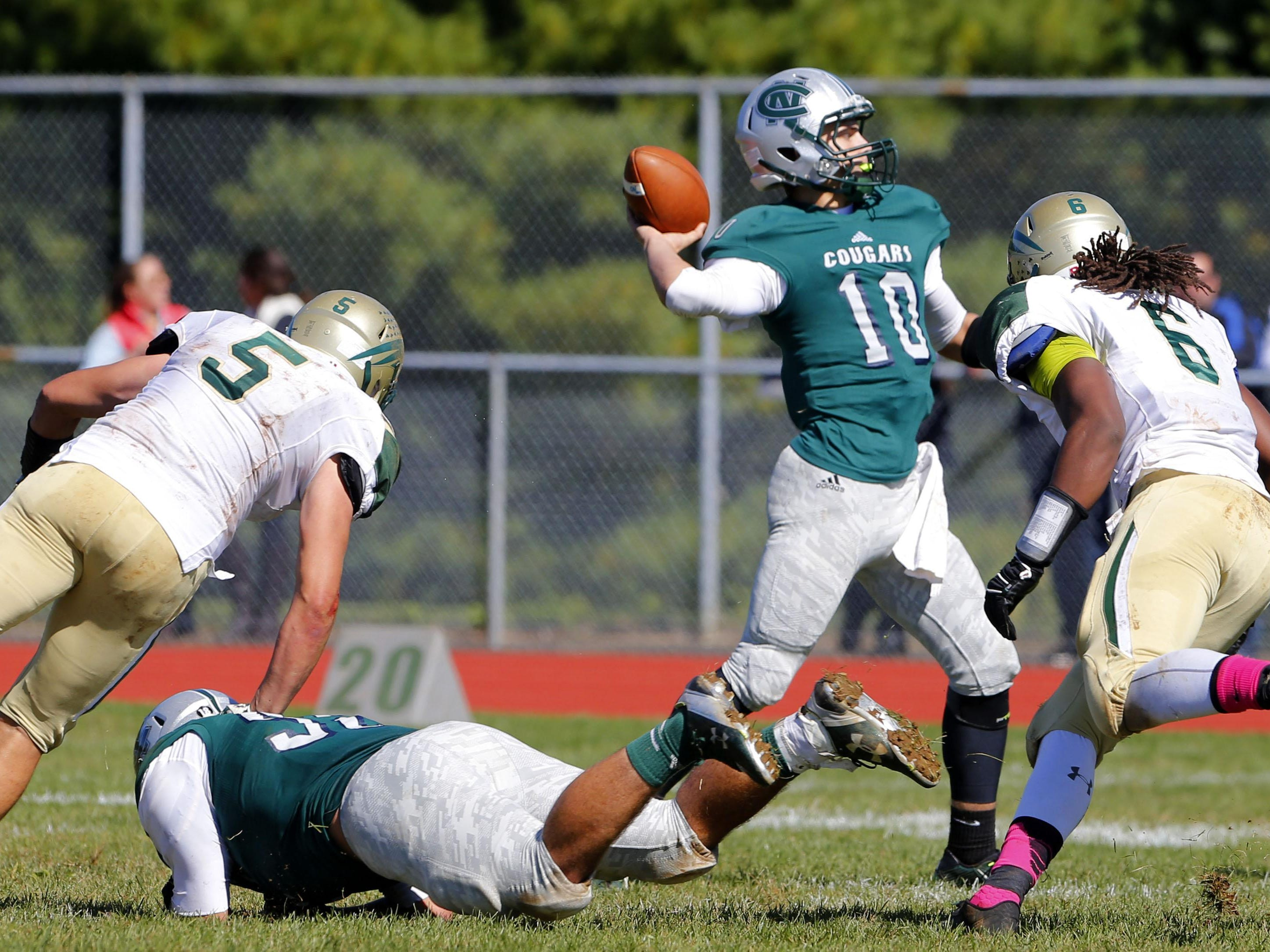 Haden Volk (10 ) of Colts Neck throws a pass to Matt Volk (3) during game against Red Bank Catholic at Colts Neck High School, Colts Neck,NJ. Saturday, October 10, 2015.