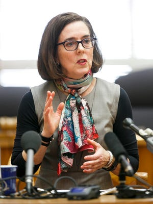 A Portland glass company has filed a $30 million lawsuit against Gov. Kate Brown.