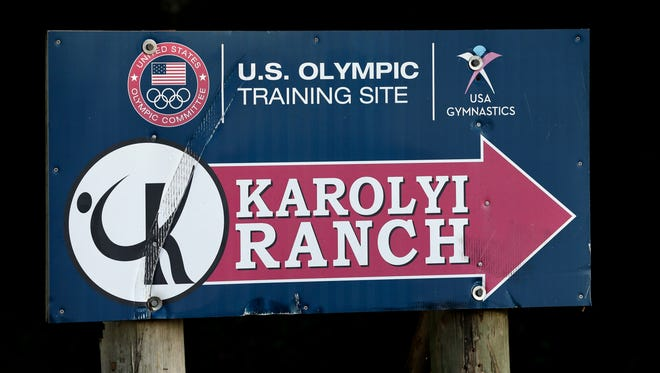 In this Sept, 12, 2015, photo, a sign points down the road to the Karolyi Ranch near New Waverly, Texas. Texas Gov. Greg Abbott on Tuesday, Jan. 30, 2018, has ordered a criminal investigation into claims that former doctor Larry Nassar abused some of his victims at the Texas ranch that was the training ground for U.S. women's gymnastics.