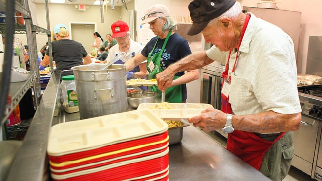 Marian Wilder serves lunch at the Grand Central Station Soup Kitchen.