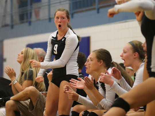 The Plymouth Wildcats also were willing participants in the charity event. Here, Jillian Betts (No. 9) tries to get her teammates pumped up.