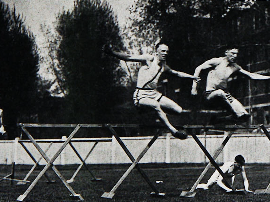 Louis Mohs running the hurdles as a member of the St.